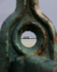 Pier through the railings