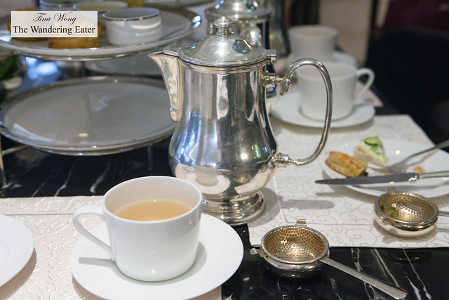 My cup of tea and heavy silver teapot