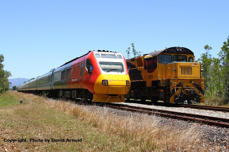 Tilt train and Sunlander cross by David Arnold