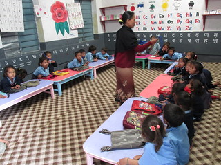 ECD teacher instructing to the children in Gramkallyna L.S. Ghanpokhara | by A dynamic education NGO working across Nepal