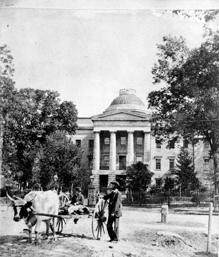 Image result for N_53_15_353 Capitol from the West with Ox Cart in Front, Before 1895 cir 1880s