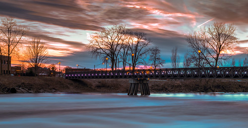 hdr indiana mishawaka nikon nikond5300 outdoor stjosephriver bridge clouds evening footbridge geotagged lights longexposure reflection reflections river sky sunset tree trees water unitedstates