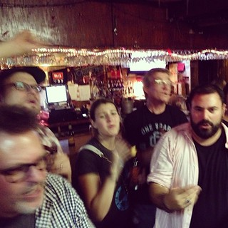 Everyone earnestly signing along to something at karaoke. These people are my people! #dpm2014 #love #aintnopartylikeapmparty