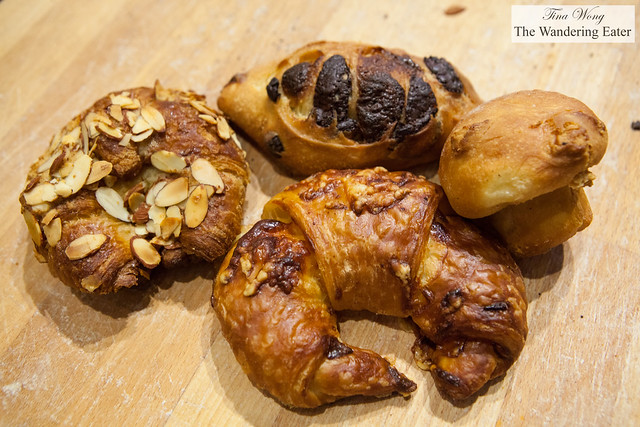 "Almond croissant, cheese croissant, chocolate viennoiserie, apple ""mushroom"" brioche"