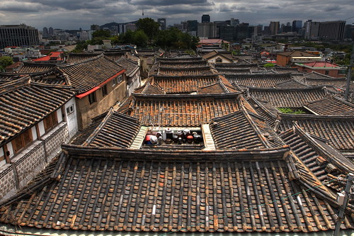 horizontal outdoors nopeople view city birdeye perspective contrast old new traditional modern hanok skyline skyscrapers background namsan mountain sky clouds cloudy day weather roof rooftops tile nseoultower hdr highdynamicrange travel travelling august 2016 summer vacation canon 5dmkii camera photography colour color bukchon bukchonhanokvillage touristic neighborhood buildings korean wooden homes seoul korea southkorea asia