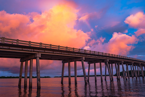 road bridge sunset red sky orange color reflection nature water horizontal architecture clouds sunrise underpass landscape outdoors bay pier us rainbow twilight gulf unitedstates florida surreal overpass wideangle nobody structure northamerica inlet waterway goldenhour firey bonitasprings loverskey
