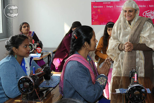 Her Holiness visits in sewing center