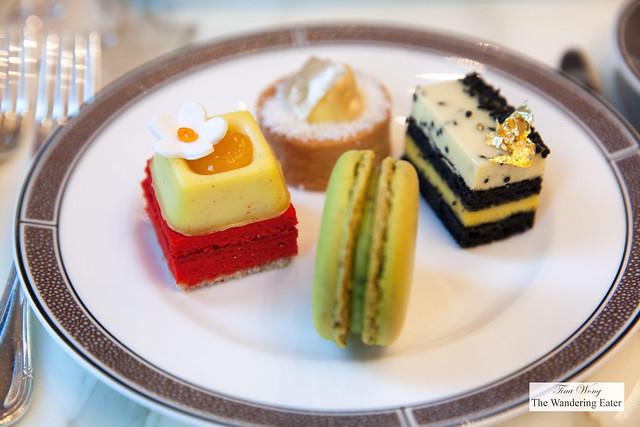 Desserts - Sencha green tea macaron; Black sesame entremet, banana Cream, vanilla mousse;  Roasted Pineapple tart, coconut custard, rice tuile; Ginger tea cake, orange cremeux, mandarin gel