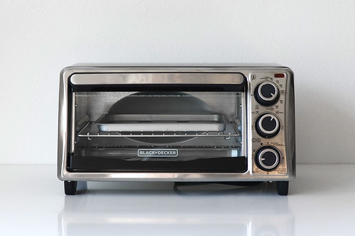 Mini silver toaster on kitchen counter