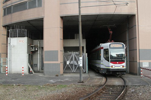 MTR Phase I LRV 1038 on route 615 departs the Yuen Long terminus