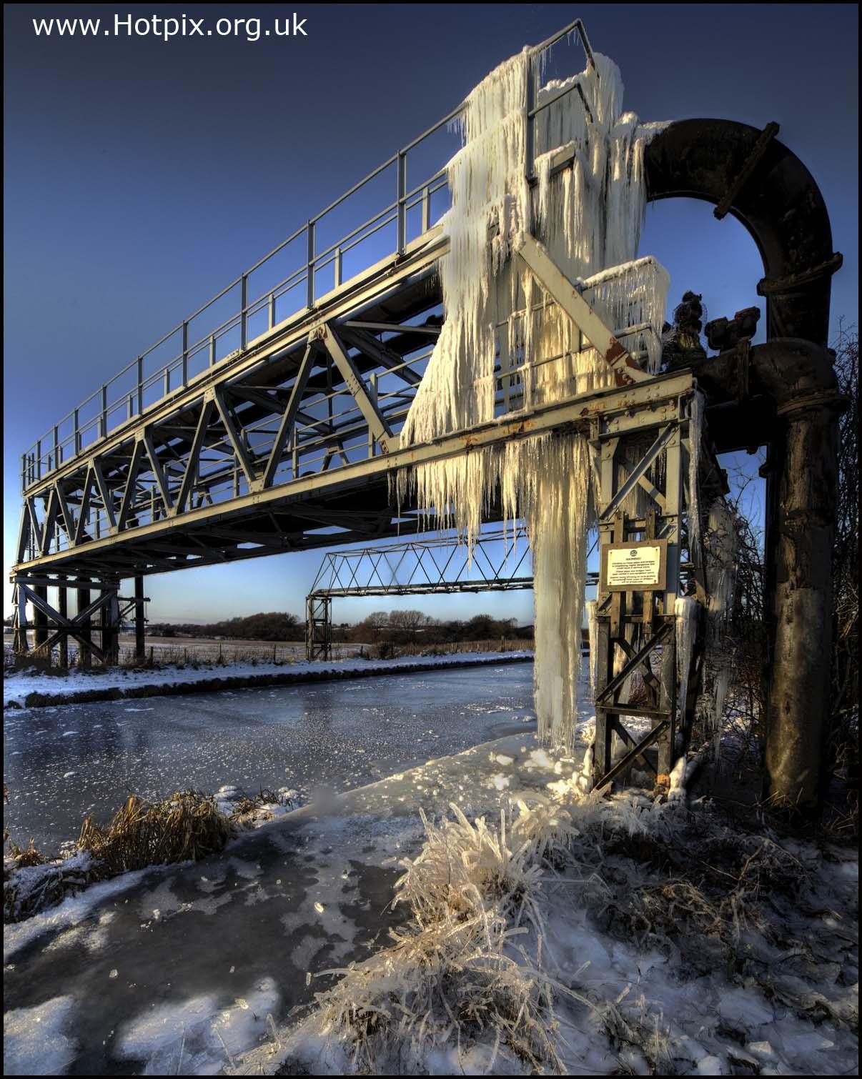 serious,icicles,ice,water,winter,cold,sheet,pipes,industry,industrial,northwich,cheshire,uk,january,2010,england,freeze,blue,sky,grass,sub,zero,subzero,hotpix,hoypixuk,tonysmith,tony,smith,bridge,gantry,walkway,navigation,navigable,waterway,way,rudheath,orchard,boat,yard,boatyard,car\u00e1mbano,del,hielo,helado,this photo rocks,HDR,high dynamic range,interesting,place,places,12-24,sigma,wide angle lens,wide