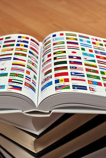 Encyclopedia pages showing world flags   by Horia Varlan