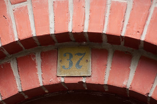 Number 37 on a yellow plaque over entrance | by Horia Varlan
