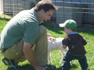 Jeff and Paul Petting Goats