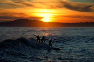 Silhouetted Surfers | by J Samuel