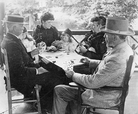 A Quiet Game - taken on the porch of the Bayley cottage near Long Branch/Une partie tranquile sur la véranda des Bayley près de Long Branch (Ont.) / Une partie tranquille sur la véranda des Bayley près de Long Branch, en Ontario. | by BiblioArchives / LibraryArchives