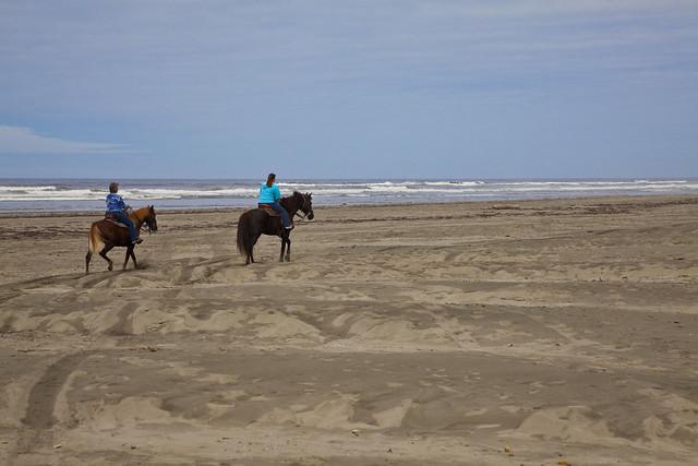 Riding on Pacific Ocean beach