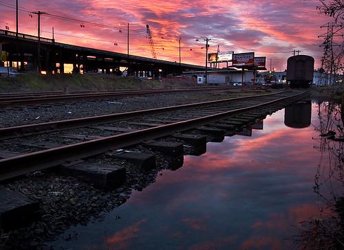 railroad morning reflection oregon train sunrise portland puddle se track hobo samtrak