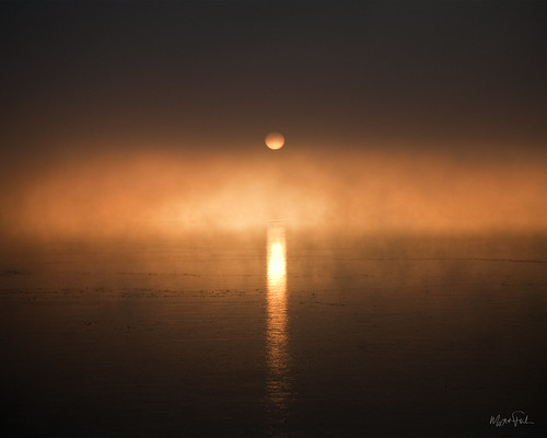 winter orange sun lake cold reflection eye ice sunrise nikon sunny reflect winnebago neenah