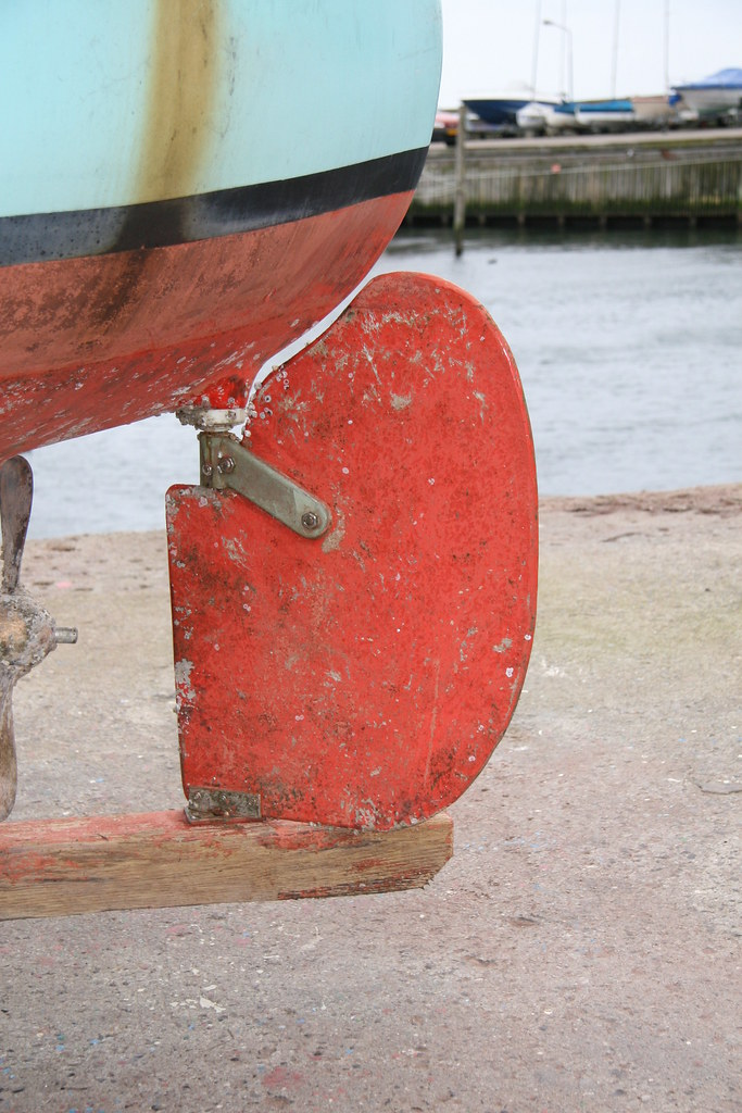 The rudder of a fisherboat at the beach