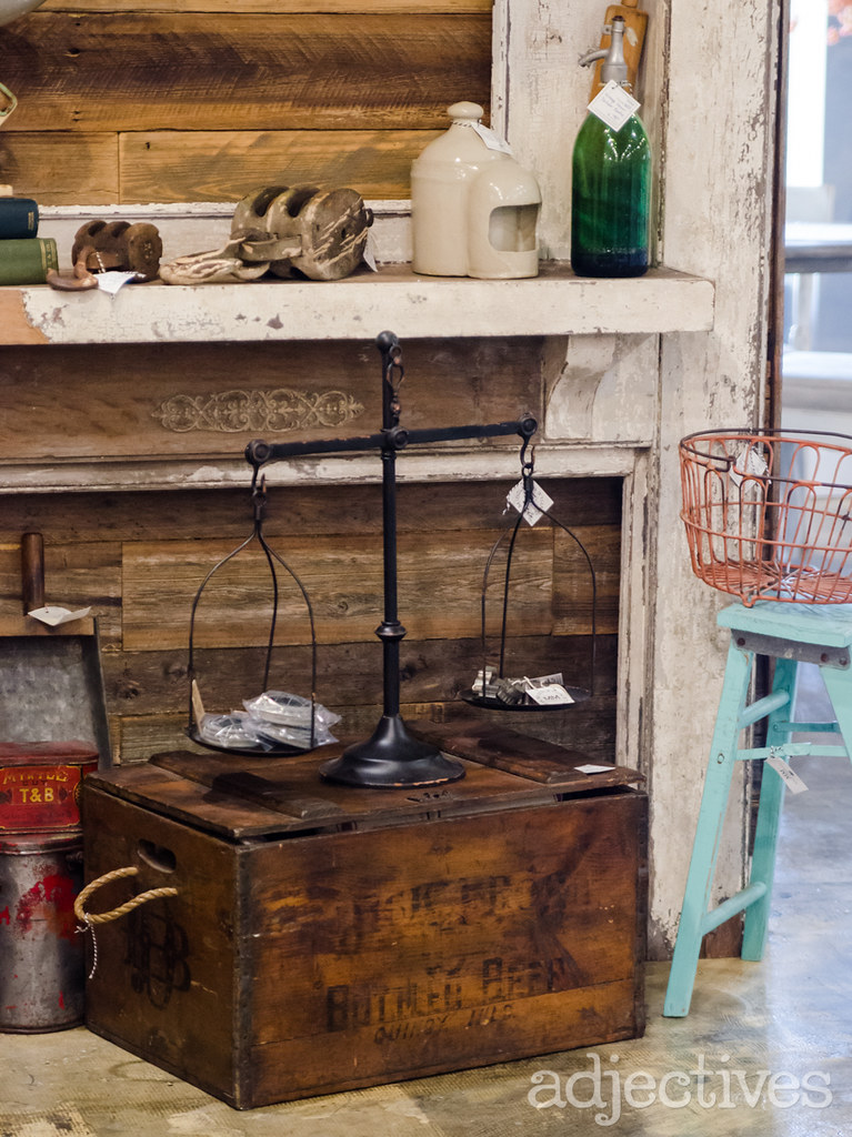 Vintage balancing scales and trunk by Middleton Mercantile in Adjectives Altamonte