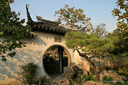 china door old city roof sunset white tree geometric window water rock stone wall pine garden circle canal bush couple downtown suzhou traditional chinese decoration entrance bluesky center ornament retreat round form prc chinesegarden channel waterway jiangsu gardencity peoplesrepublicofchina chinesevenice couplesretreatgarden