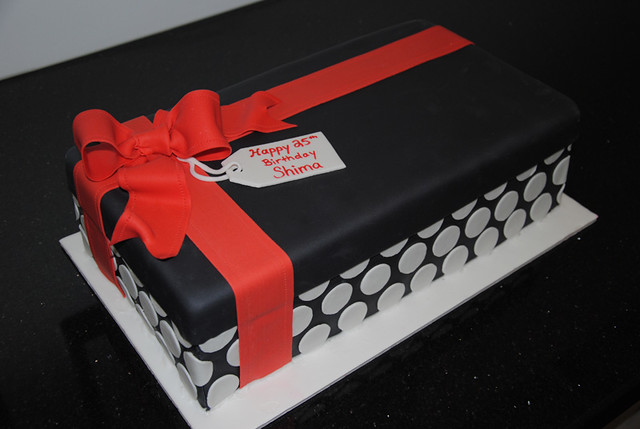 Black, red and white gift box cake