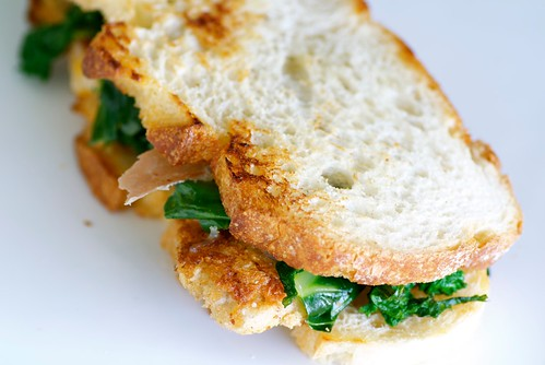 veal cutlet sandwich with garlicky greens, smoked mozzarella, and prosciutto   by Food Blogga