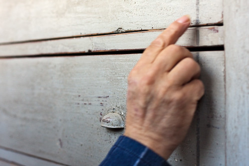 Man's hand touching drawer with crackle paint finish | by Old Photo Profile