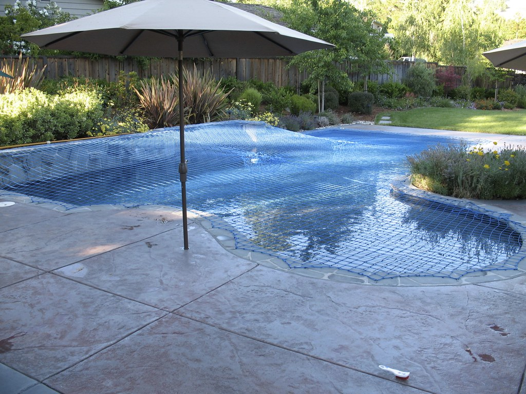 Blue Katchakid pool safety net cover with raised back wall ...