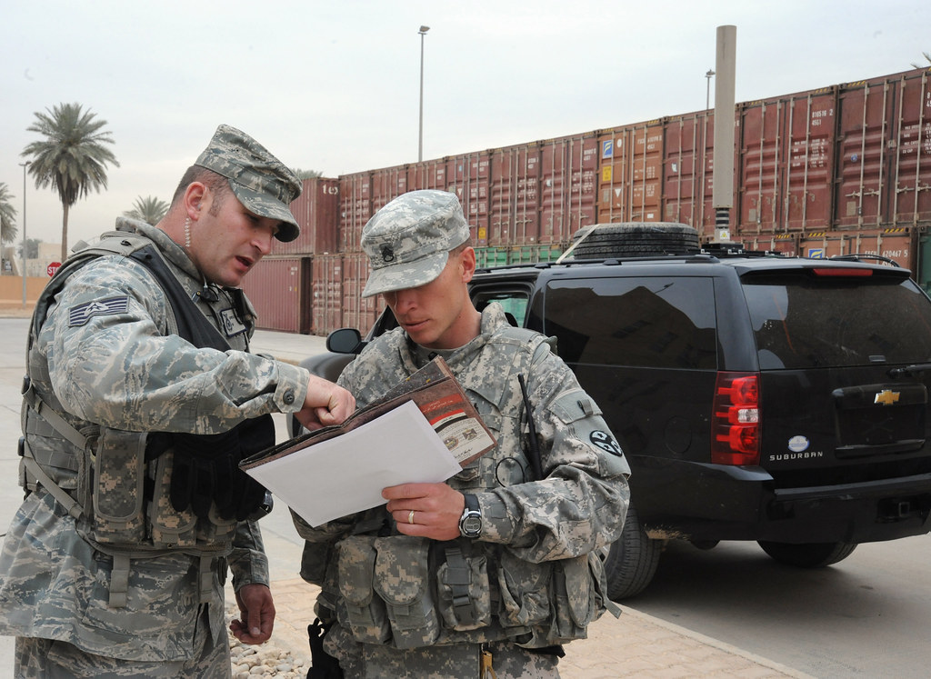Air Guardsman discusses transportation information with a … | Flickr