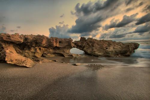 sunrise sand rocks day cloudy tide jupiterbeach way2fnearly