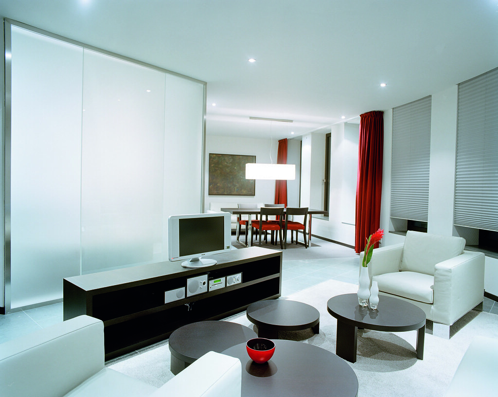 White modern spacious trendy futuristic living room of the ...