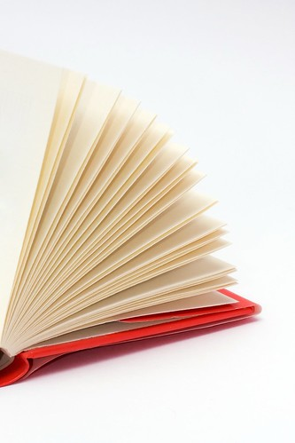 Red hardcover book with flipping pages | by Horia Varlan