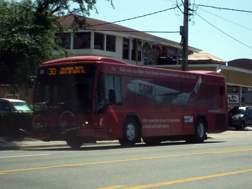 LYNX Bus 706 - Red Ad-wrapped TAM Plane | This bus if from t