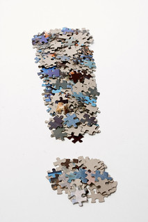 Fat exclamation mark made from jigsaw puzzle pieces | by Horia Varlan