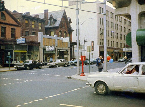 New Haven, Connecticut at Crown and College Street with 1970s cars and the Exorcist movie at right at the Roger Sherman Theater. July 1974 | by wavz13