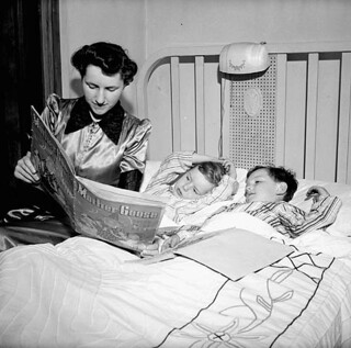 Mrs. Jack Wright reads her two sons Ralph and David a bed-time story / À l'heure du coucher Mme Jack Wright lit une histoire à ses deux fils, Ralph et David | by BiblioArchives / LibraryArchives