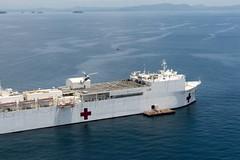 USNS Mercy (T-AH 19) sits at anchor off the coast of Roxas City, July 21. (U.S. Navy/MC1 Trevor Andersen)