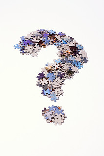 Question mark made of puzzle pieces   by Horia Varlan
