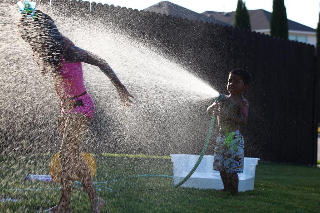 video-dirt-water-hose-bikini-boobs-massage
