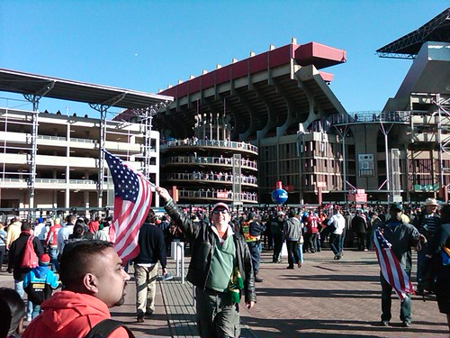 Andy waves US flag outside Ellis Stadium | by IdoNotes