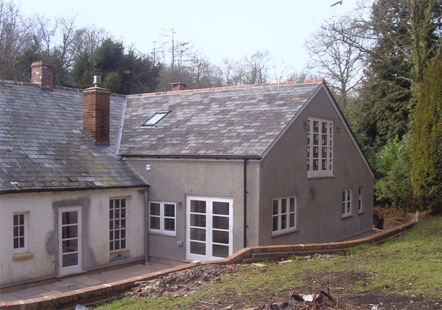 <p>Existing cob house. Built two storey extension, using reclaimed slates to match. Built brick retaining wall and patio.</p>