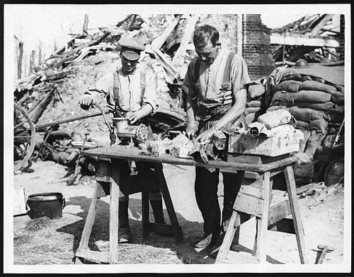 Cooks of the K.O.Y.L.I. preparing a meal for the men in the trenches   by National Library of Scotland
