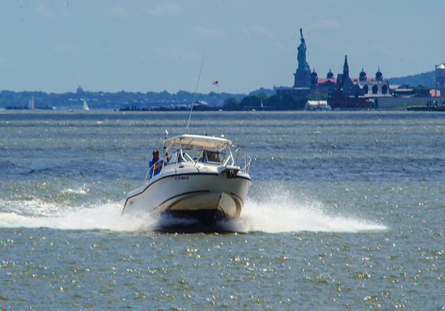 Boating On Hudson River with skyline of Statue Liberty and Ellis Island in View