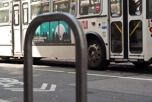 11075 SFIAAFF 2010 Muni bus queen seen through U-rack on Market near 5th   by geekstinkbreath