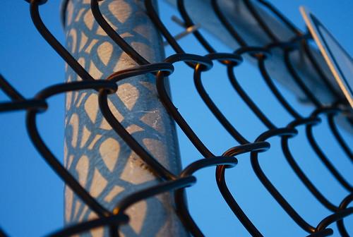 light sunset shadow snow fence chainlink loops syracuse syracuseny