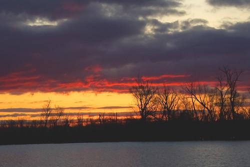 red sun lake clouds sunrise louisiana shreveport bickhamdicksonpark