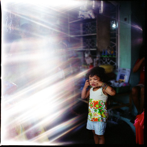 light man 120 film girl analog mediumformat glare child philippines young hasselblad half leak cavite quezoncity 500cm hasselblad500cm ilovefilm fujifilmpro800z
