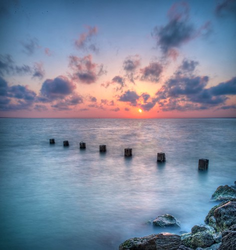 longexposure sunset sky reflection beach gulfofmexico water clouds evening rocks wind florida clearwaterbeach clearwater nikond700 vertorama andrewvernon aperture3